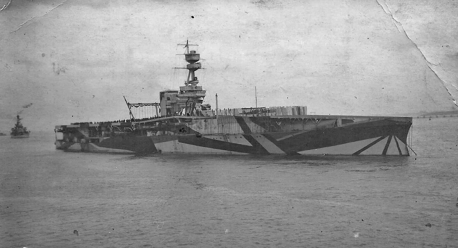 HMS Furious at anchor with aircraft on deck